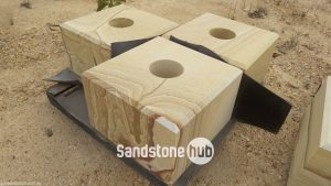 Sandstone Square blocks Diamond cut with hole in the middle on pallet yellow stripe