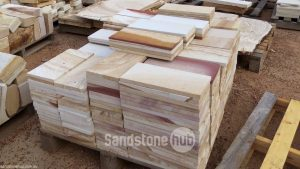 Sandstone Tiles and Pavers Assortment of Natural Colours Stacked on Pallet