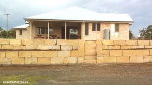 Sandstone Retaining Wall Completed With Wheel Sawn Blocks At New Housing Estate