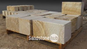 Sandstone Blocks and Logs Rockfaced with Diamond Sawn Sides Yellow Colour Stacked on Pallet