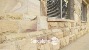 Sandstone Rockfaced Wall Cladding on Front of House Yellows and Brown Colours