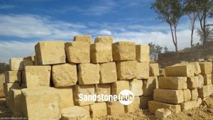 Sandstone AGrade 5 Wheel Sawn Sides Yellow Stacked in Quarry Reserve