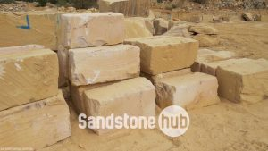 Sandstone BGrade Blocks and Logs Stacked In Quarry