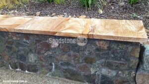 Sandstone Cladding Capping And Tile Product On Stone Wall Pathway