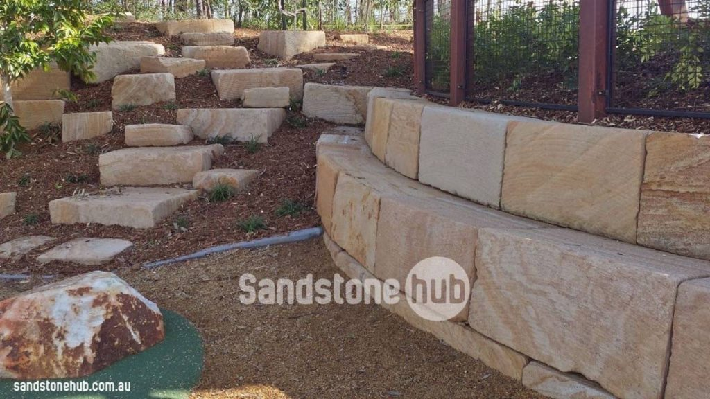 Sandstone Blocks Logs Retaining Wall And Outdoor Landscaping