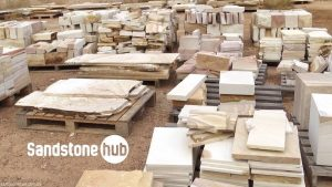 Sandstone Mixed Products Slabs Tiles Blocks Diamond Sawn on Pallets in Quarry Reserve