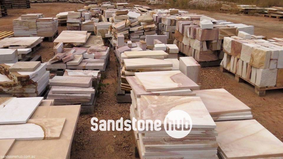 Sandstone Factory Reserve Yard with Stacked Mixed Product on Pallets