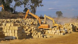 Sandstone Quarry Block Stacking and Processing with Heavy Machinery