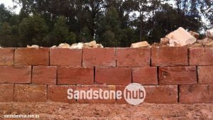 Sandstone Retaining Wall Under Construction With Wheel Sawn Red Blocks