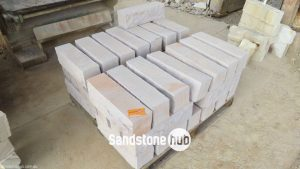 Sandstone Rockfaced Blocks and Garden Edging White and Orange Tones Stacked on Pallet