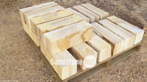 Sandstone Rockfaced Garden Edging Yellow Tones Stacked on Pallet
