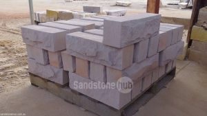 Sandstone Rockfaced Garden Edging Mauve Colours Stacked on Pallets
