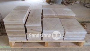 Sandstone Diamond Sawn Tiles and Pavers Stacked on Pallets Multi Coloured