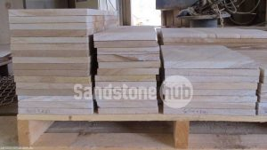 Sandstone Diamond Sawn Tiles, Pavers and Slabs Stacked on Pallets